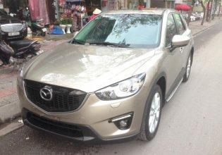 Cần bán xe Mazda CX-5, sản xuất và đăng ký 2013 mầu vàng cát. Giá 665 triệu giá 665 triệu tại Hà Nội