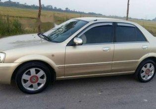 Cần bán Ford Laser 1.8MT năm 2003, màu vàng chính chủ giá cạnh tranh giá 185 triệu tại Nghệ An