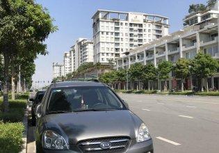 Cần bán gấp Kia Carens EX 2010, màu xám giá 325 triệu tại Tp.HCM
