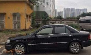 Bán Ford Laser 1.8 AT 2004, màu đen, giá tốt giá 208 triệu tại Hà Nội