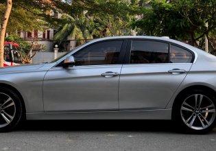 Bán BMW 320i Sportline 2014 màu bạc chính chủ giá 828 triệu tại Tp.HCM