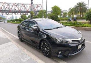 Bán xe cũ Toyota Corolla altis 2.0V đời 2015, màu đen giá 720 triệu tại Tp.HCM