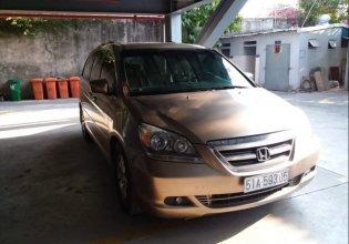 Gia đình bán Honda Odyssey đời 2007, màu vàng, nhập khẩu giá 620 triệu tại Tp.HCM