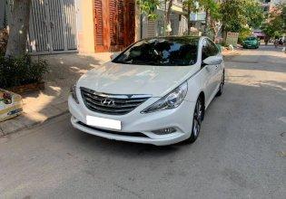 Gia đình cần bán Sonata 2012, số tự động, màu trắng giá 567 triệu tại Tp.HCM