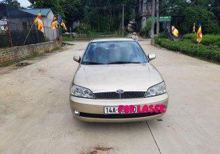 Bán Ford Laser 1.8 sản xuất 2002, màu vàng, giá 145tr giá 145 triệu tại Hà Nội