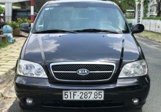 Cần bán xe Kia Carnival 2.5AT đời 2009, màu đen giá 299 triệu tại Tp.HCM