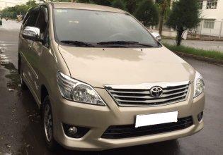 Cần bán Toyota Innova E đời 2013, màu vàng giá cạnh tranh giá 420 triệu tại Tp.HCM
