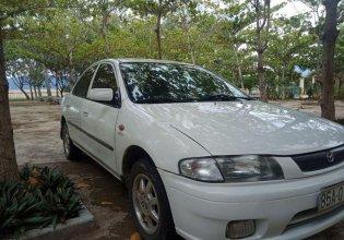 Gia đình bán Mazda 323 1.6 đời 2000, màu trắng, xe nhập giá 110 triệu tại Ninh Thuận