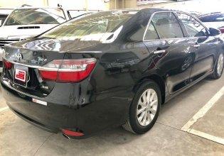 Bán Toyota Camry 2.0E sản xuất 2015, màu đen số tự động giá 820 triệu tại Tp.HCM