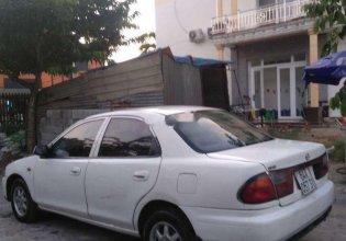 Cần bán gấp Mazda 323 sản xuất năm 1999, màu trắng, nhập khẩu giá 90 triệu tại Vĩnh Long