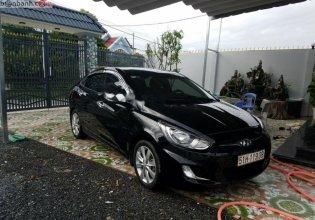Chính chủ bán Hyundai Accent 1.4 AT đời 2012, màu đen, nhập khẩu nguyên chiếc giá 370 triệu tại Tp.HCM