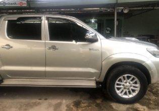 Bán lại xe Toyota Hilux 2.5E 4x2 MT sản xuất 2014, màu bạc, xe nhập   giá 438 triệu tại Bình Dương
