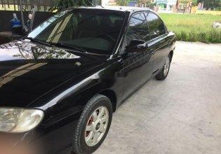 Cần bán lại xe Kia Spectra sản xuất 2003, màu đen, xe nhập chính chủ giá 95 triệu tại Hải Dương