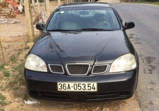 Cần bán lại xe Daewoo Lacetti sản xuất năm 2004, màu đen giá 115 triệu tại Yên Bái