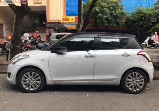 Bán Suzuki Swift 1.4 AT đời 2015, màu trắng giá 420 triệu tại Hà Nội