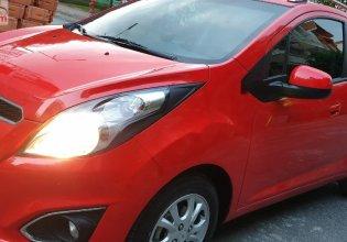 Cần bán lại xe Chevrolet Spark LTZ AT sản xuất 2013, màu đỏ số tự động giá cạnh tranh giá 235 triệu tại Tp.HCM