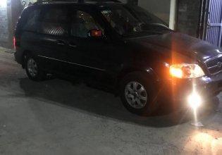 Bán xe cũ Kia Carnival LS 2.5 MT 2007, màu đen, 265 triệu giá 265 triệu tại Tp.HCM