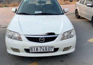 Cần bán gấp Mazda 323F GLX đời 2004, màu trắng giá 145 triệu tại Bình Dương