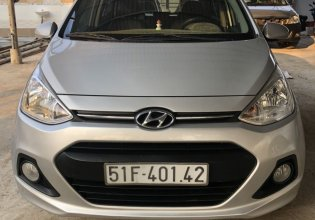 Cần bán lại chiếc Hyundai Grand i10 AT hatchback sản xuất 2015, màu bạc, nhập khẩu nguyên chiếc giá 325 triệu tại Tp.HCM