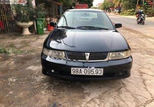 Cần bán Mitsubishi Lancer GLXI 1.6 MT sản xuất 2003, màu xanh lam xe gia đình giá 125 triệu tại Bắc Giang