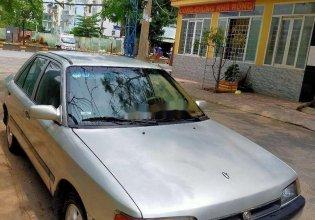 Cần bán lại xe Mazda 323 năm sản xuất 1996, màu bạc, nhập khẩu nguyên chiếc giá 60 triệu tại Tp.HCM
